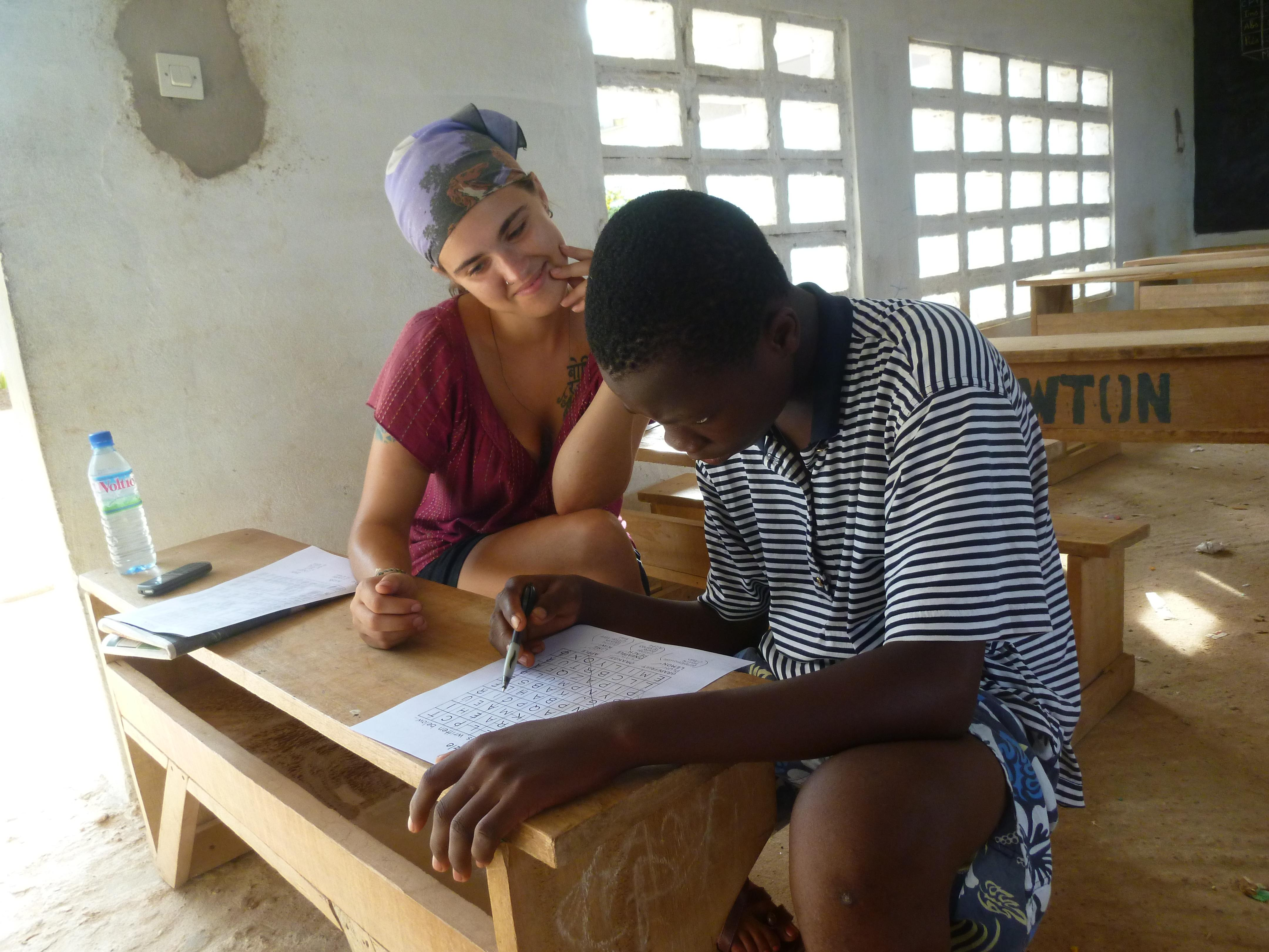 A young man participates in a therapy session run by a student doing a Speech Therapy internship in Africa.